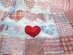 100 hearts patchwork quilt in red 1